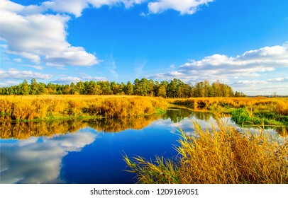River sky clouds reflection landscape. Autumn river panorama. River autumn landscape. Autumn forest river view