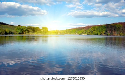 River sky and clouds spring forest landscape green
