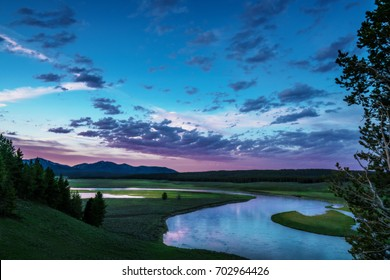 River Snakes Through the Valley at Twilight