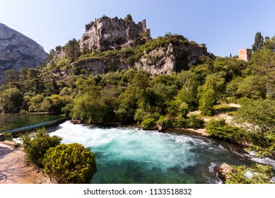 The river Sorgue in Fontaine de Vaucluse in the background the castle ruins from Philp Cabassole. Vaucluse, Provence, France, Europe