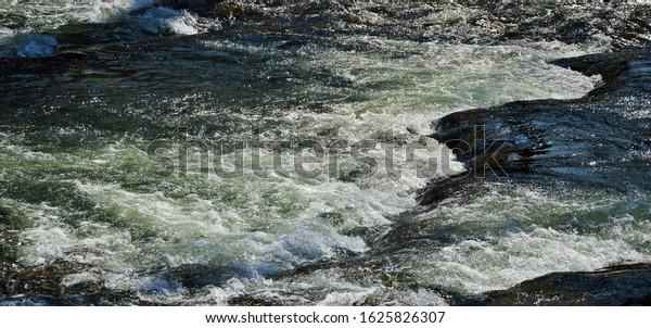 river-stones-background-600w-1625826307.
