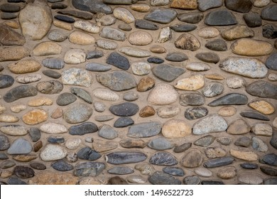 river stones cemented into a wall
