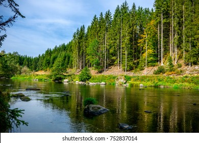 River with Stones and Moss in the autumn in the bavarian forest