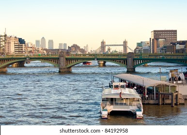 The river Thames with London Bridge,Tower Bridge and Canary Wharf in the distance
