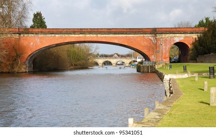 The River Thames in Maidenhead Berkshire, with Brunels Sounding Arch Railway Bridge in the foreground
