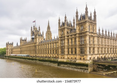 River Thames and Palace of Westminster (known as Houses of Parliament). Palace of Westminster located on Middlesex bank of River Thames in City of Westminster, London.