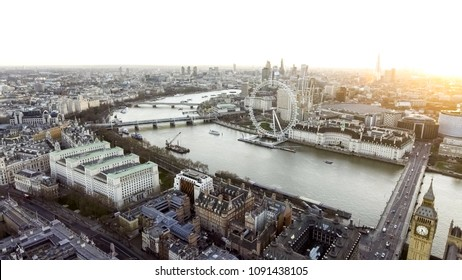 The River Thames passes through the Centre of London with the Touristic District Big Ben and Iconic Riverside Observation Wheel on opposite sides