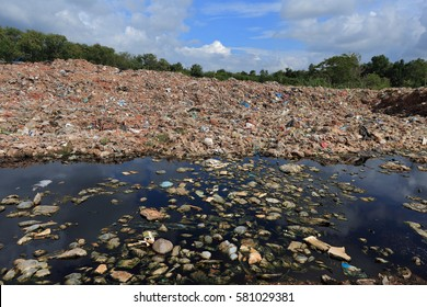 River that is polluted with various garbage and trash.