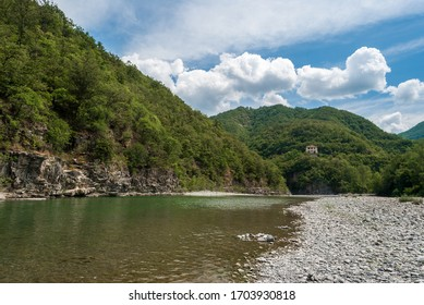 The river Trebbia and the surrounding hills during the summer (Emilia Romagna, Italy)