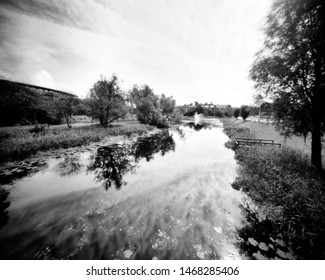 river and trees in the spring, this black and white camera obscura photo is NOT sharp due to camera characteristic. Taken on analogue photographic large format negative film with a pinhole camera