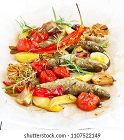 River trout baked with vegetables on baking paper.