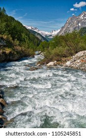 the river in Val Ferret during the melting of snow in spring, Aosta Valley - Italy