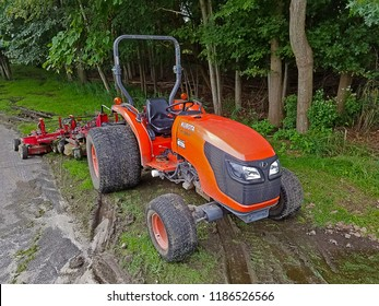 RIVER VALE, NEW JERSEY/USA - SEPTEMBER 14, 2018: A Kubota MX1500 with an attached grass cutter. These pieces of machinery are used to cut grass along various area along the golf course.