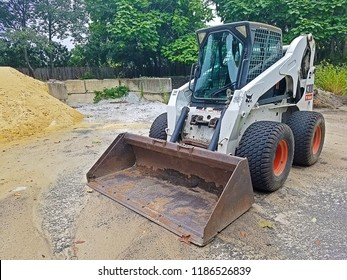 RIVER VALE, NEW JERSEY/USA - SEPTEMBER 7, 2018: A Bobcat A300 parked in a construction zone. These small pieces of machinery have an enclosed cab with heat and air conditioning.