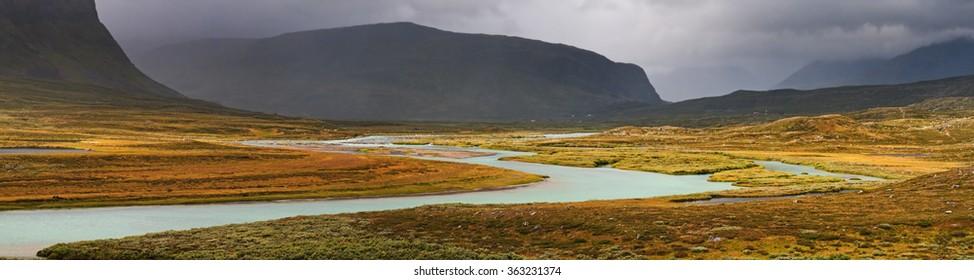 River valley in  Alpine tundra of Sarek national Park in Sweden.