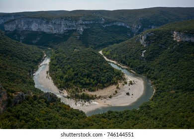 river in a valley in the ardeche