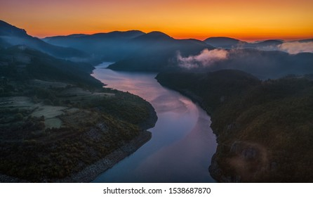 River valley during magical sunrise with clouds