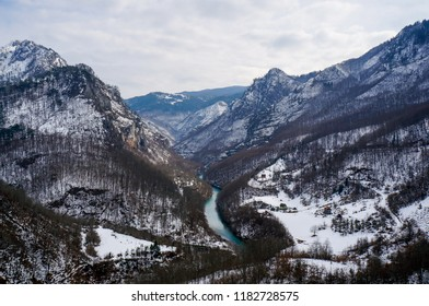 River valley going through the mountains in a winter landscape. Tara river canyon in Durmitor National Park, Montenegro.