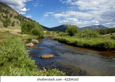 a river in the valley of rocky mountain national park