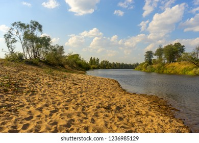 River valley with sand beach at sunny day