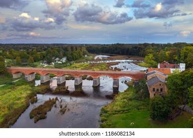 River Venta, old brick bridge and waterfall Ventas rumba in Kuldiga, Latvia.