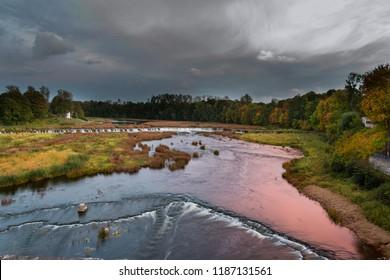River Venta and waterfall Ventas rumba in evening time. Kuldiga, Latvia.