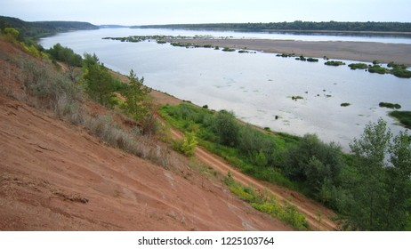 River water, cliff and sandbank