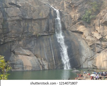 River water flowing down the high mountain cliff rocks and splashing at hundru falls Jharkhand India