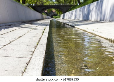 River water runs through an artificial canal in the city