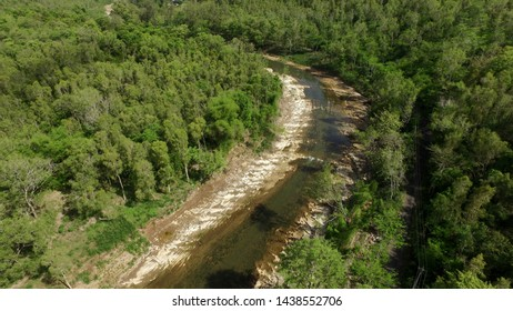 river water that continues to flow even in the dry season, limestones in the middle river of conservation karst forests view from above with aerial drone camera