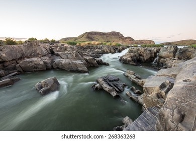 River to waterfall at sunset, South Africa