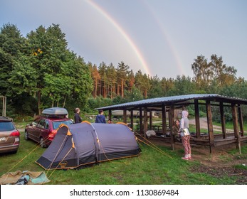 River Wda, Poland - August 21, 2016: Tents, rainbow,, car and the people  on the camping at a  bank of a the river Wieprza