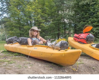 River Wda, Poland - August 26, 2016: Woman on the kayak,  during canoeing  excursion on the folding kayak. Bory Tucholskie.