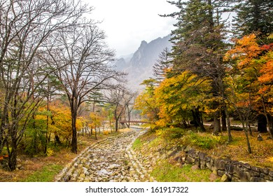 River with white stone river bed at Seoraksan national park during autumn season.
