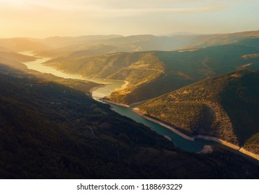 River winding in the mountain at sunset aerial view