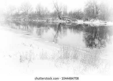 the river in winter during a snowfall