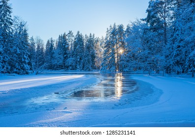 River in winter and tree branches covered with white snow
