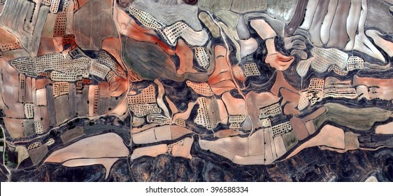 the river,allegory, tribute to Picasso, abstract photography of the Spain fields from the air, aerial view, representation of human labor camps, abstract, cubism, abstract naturalism,