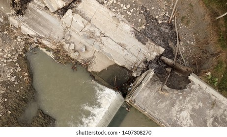 riverbank embankment that collapsed due to overflowing river water view from above with aerial drone camera in Asia, riverside image