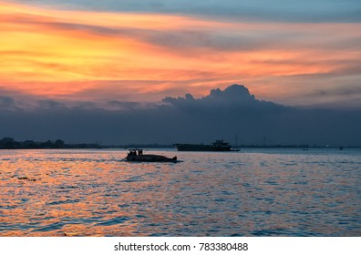 Riverboat cruising in the Mekong delta during sunset in Vietnam