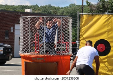 RIVERDALE, NJ, USA  - September 6, 2021: Dunk tank at Riverdale's annual labor day street fair at 83 Newark Pompton Turnpike in Riverdale, NJ. Editorial use only.