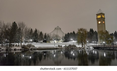 Riverfront park after dark blanketed in a fresh snowfall