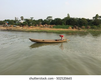 Riverside Bank and a tiny fishing boat