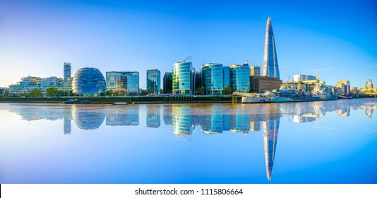 Riverside panorama of London with reflection