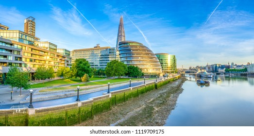 Riverside panorama of London skyline with reflection