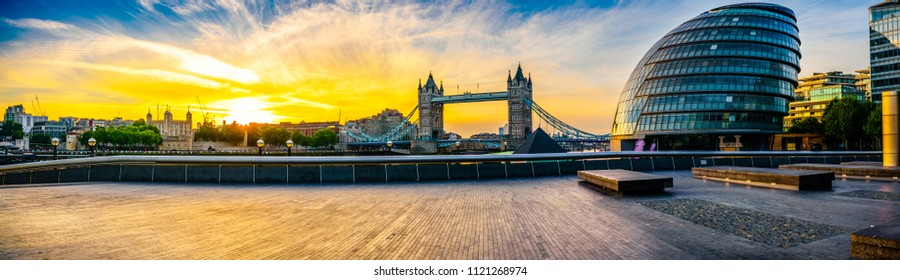 Riverside panorama of London with Tower Bridge at sunrise