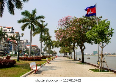 Riverside Park that runs along the Tonlé Sap River and the Preah Sisowath Quay in Phnom Penh, Cambodia, where a Cambodian flag flutters in the breeze.