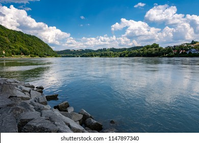 Riverside in Passau (Bavaria, Germany), the Inn river is flowing into the Danube .
