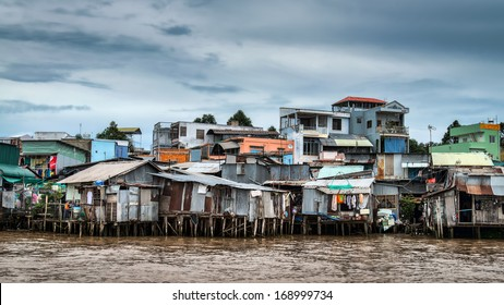 Riverside stilt houses in the Mekong Delta, south west of Can Tho, Vietnam