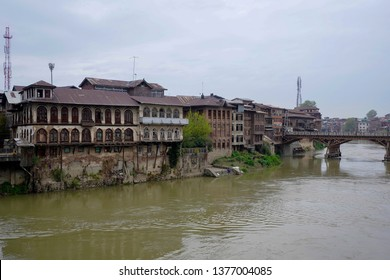 Riverside view of old town Srinagar the famous place from one of the ancient bridges across Jhelum River, Jammu and Kashmir, India is the travel destination in Kashmir, India.